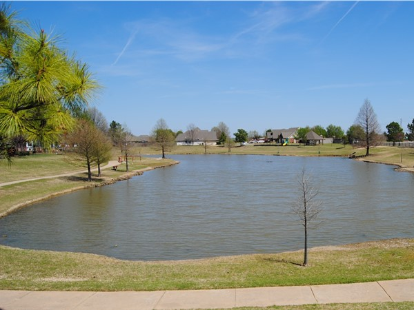 A view of one of two ponds with a walking trail, gazebo and playground to enjoy your afternoon