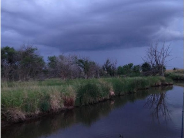 Amazing view of a storm rolling in over a creek near Lahoma