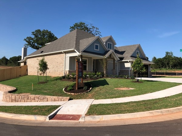 Model home at neighborhood entrance