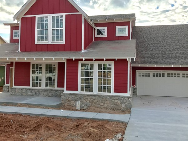 Craftsman isn't the only style you will find in Town Square, check out this red farmhouse