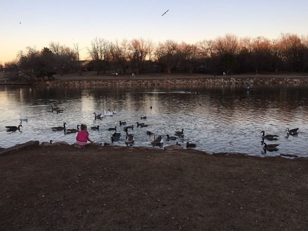 Sunset at Yukon City Park. Residents feed ducks, fish, walk trails and enjoy the 2 playgrounds