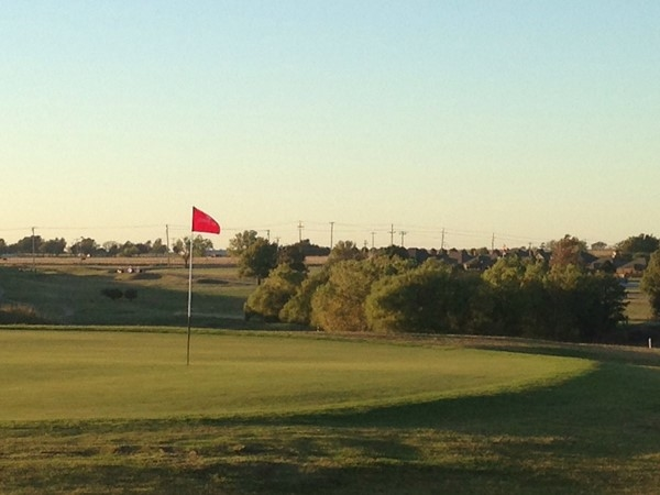 El Reno residents enjoy a nice fall evening on the Crimson Creek Golf Course